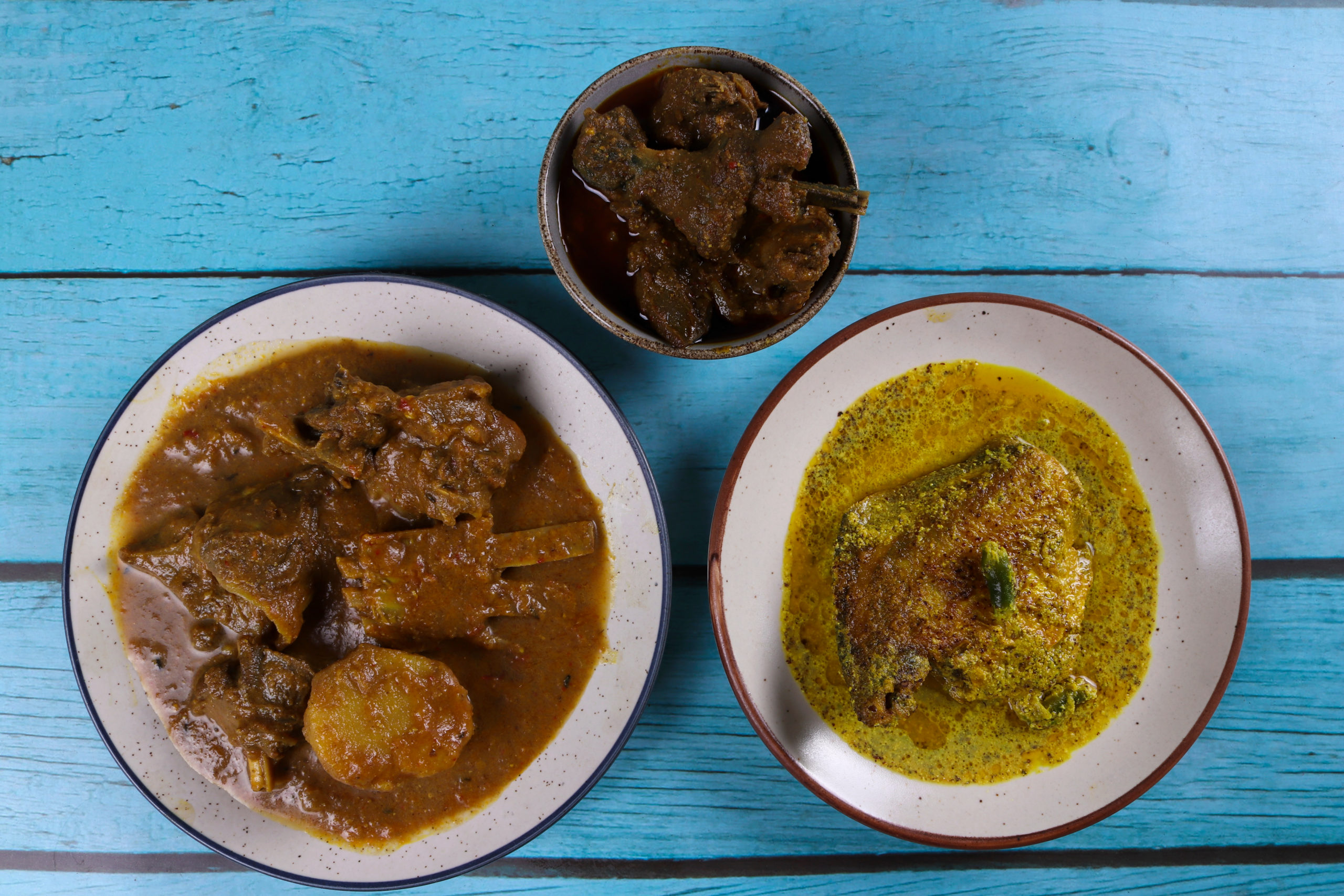 Bangladeshi cuisine including mutton, chicken, and fish curries
